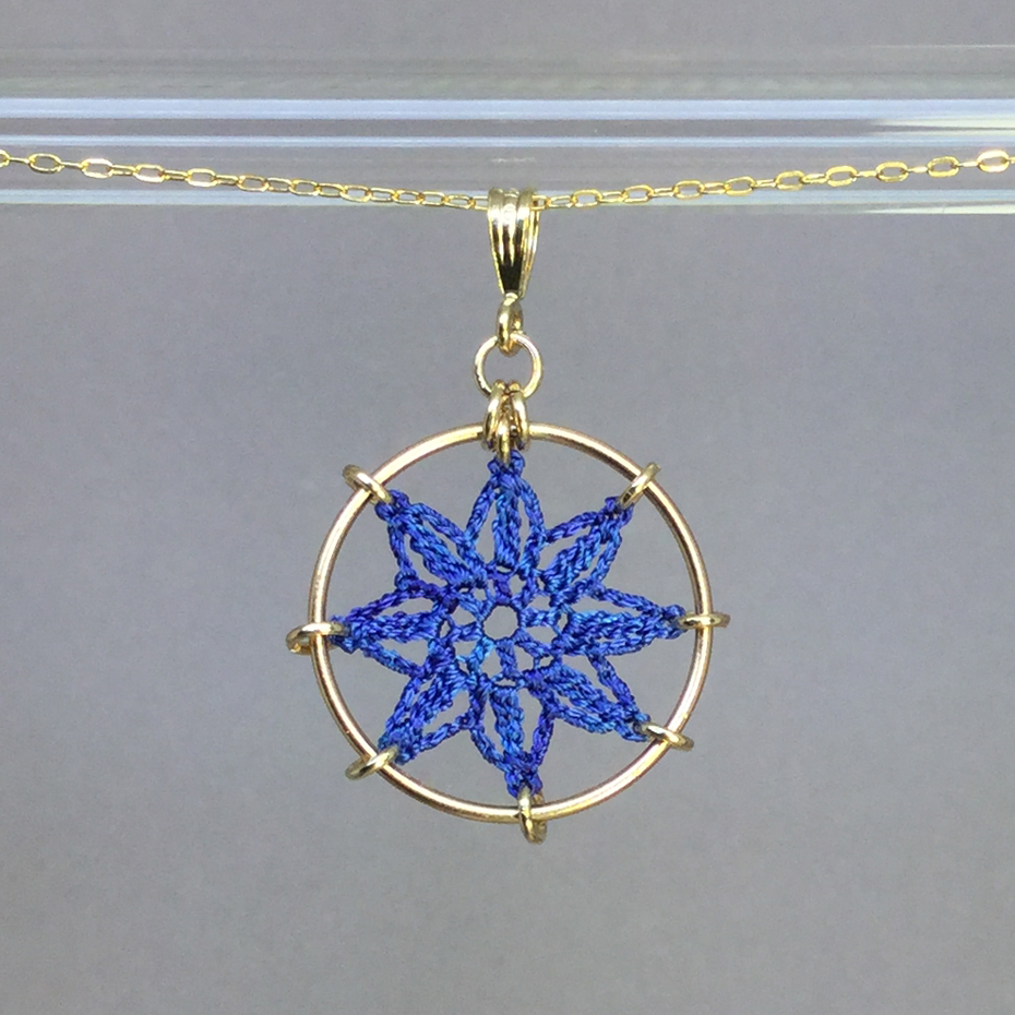 Compass Rose necklace, gold, blue thread
