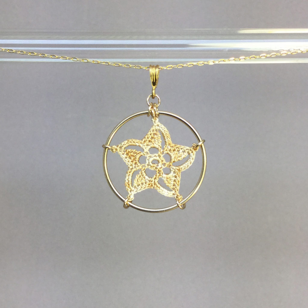 Pinwheel Star necklace, gold, french vanilla thread