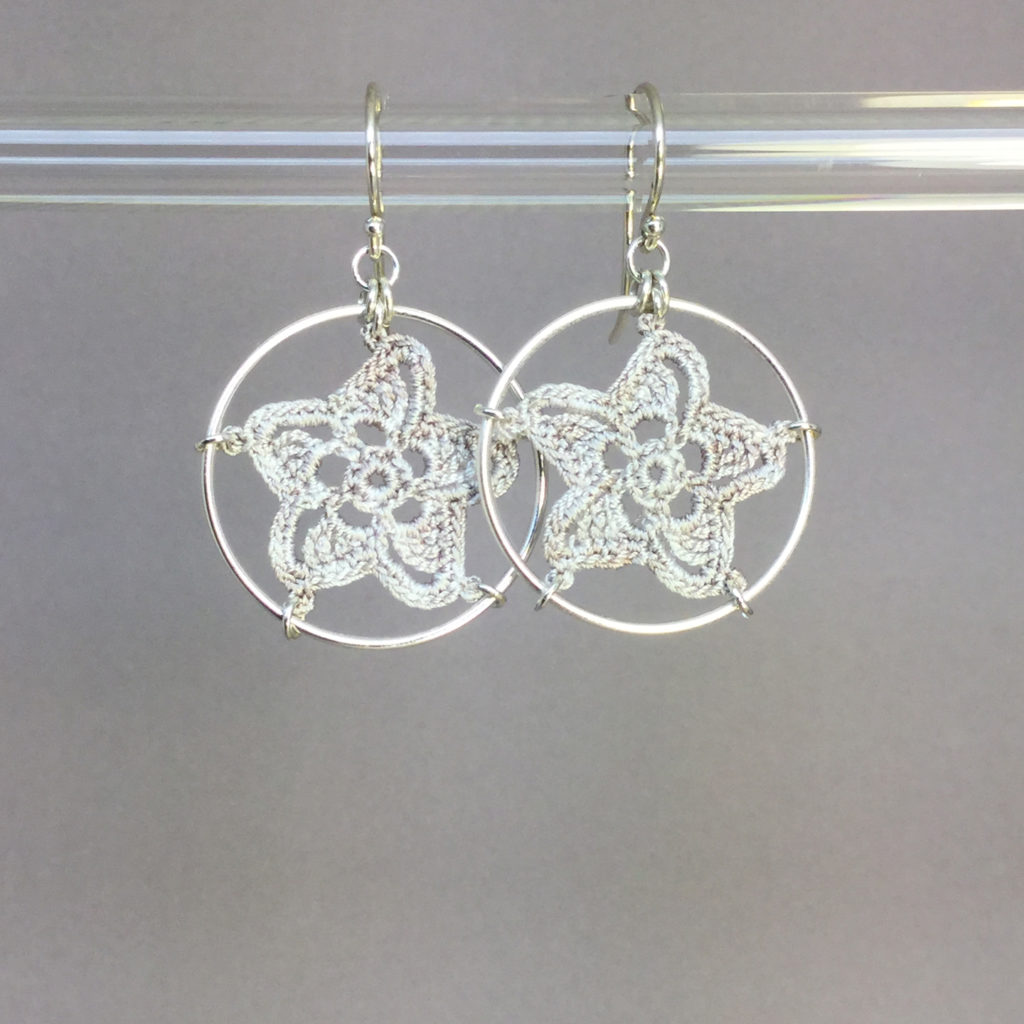 Pinwheel Star earrings, silver, pearly thread