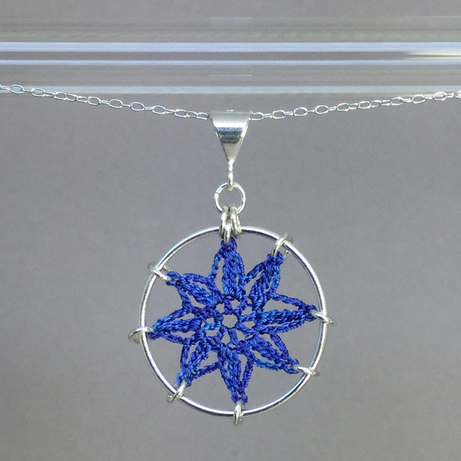 Compass Rose necklace, silver, blue thread