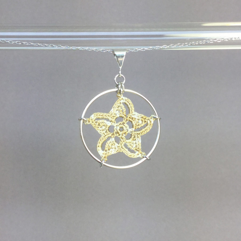 Pinwheel Star necklace, silver, french vanilla thread