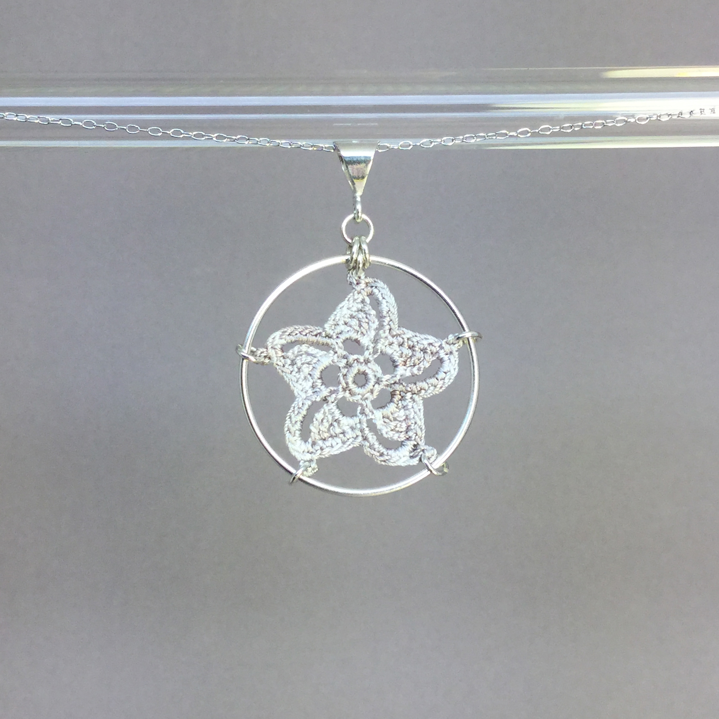 Pinwheel Star necklace, silver, pearly thread
