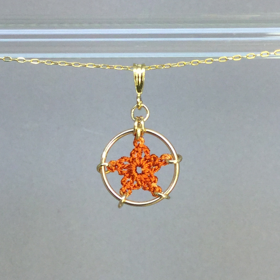 Star necklace, gold, orange thread
