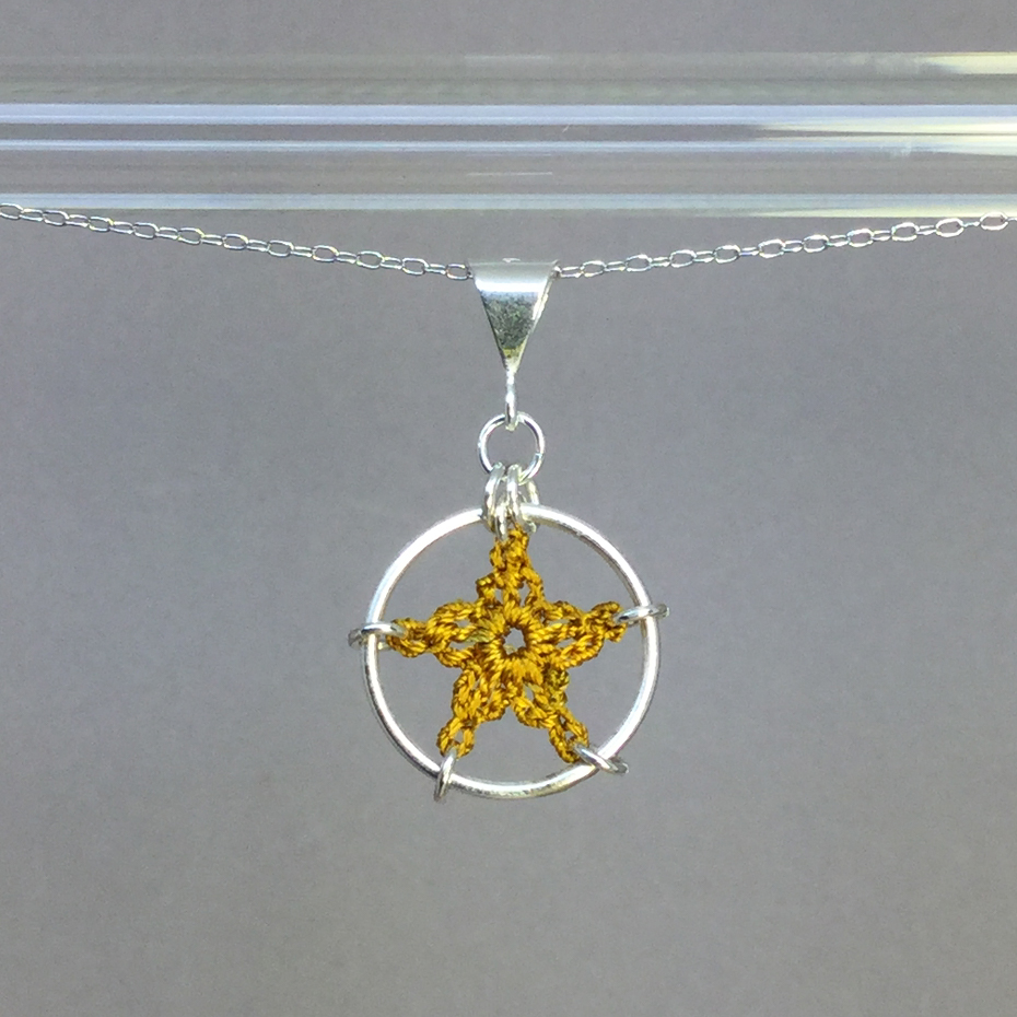 Star necklace, silver, ochre thread