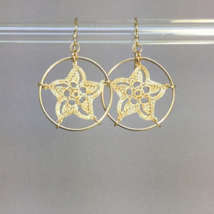 Pinwheel Star earrings, gold, french vanilla thread