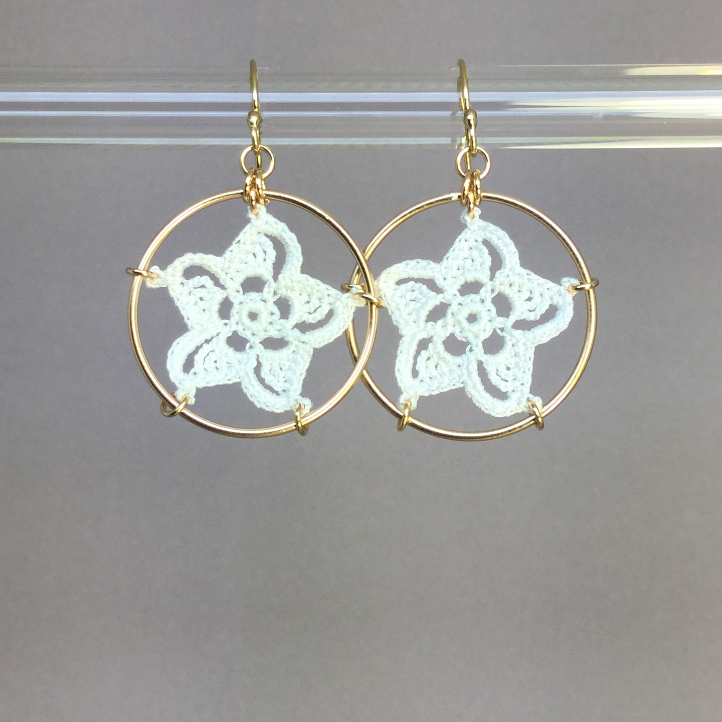 Pinwheel Star earrings, gold, white thread