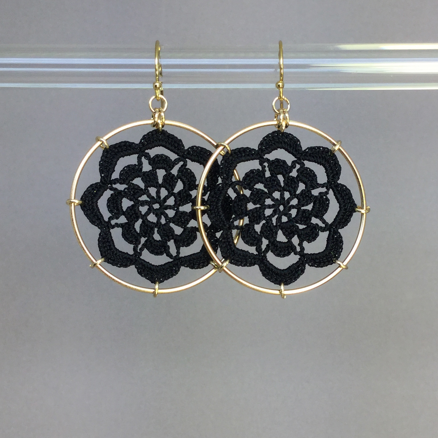 Serendipity earrings, gold, black thread