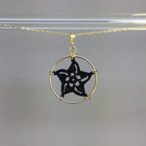 Pinwheel Star necklace, gold, black thread