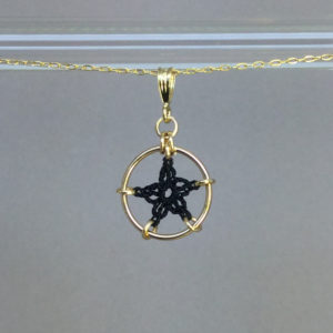 Star necklace, gold, black thread