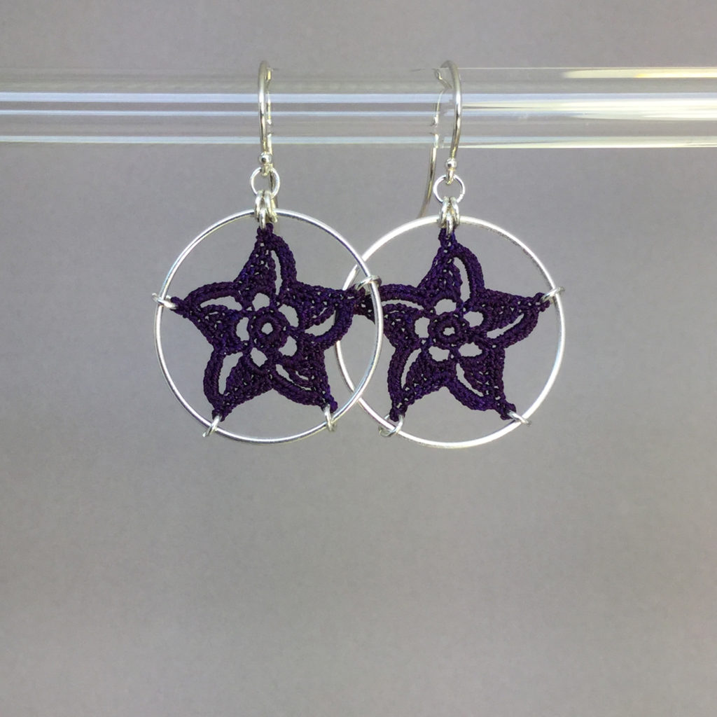 Pinwheel Star earrings, silver, purple thread