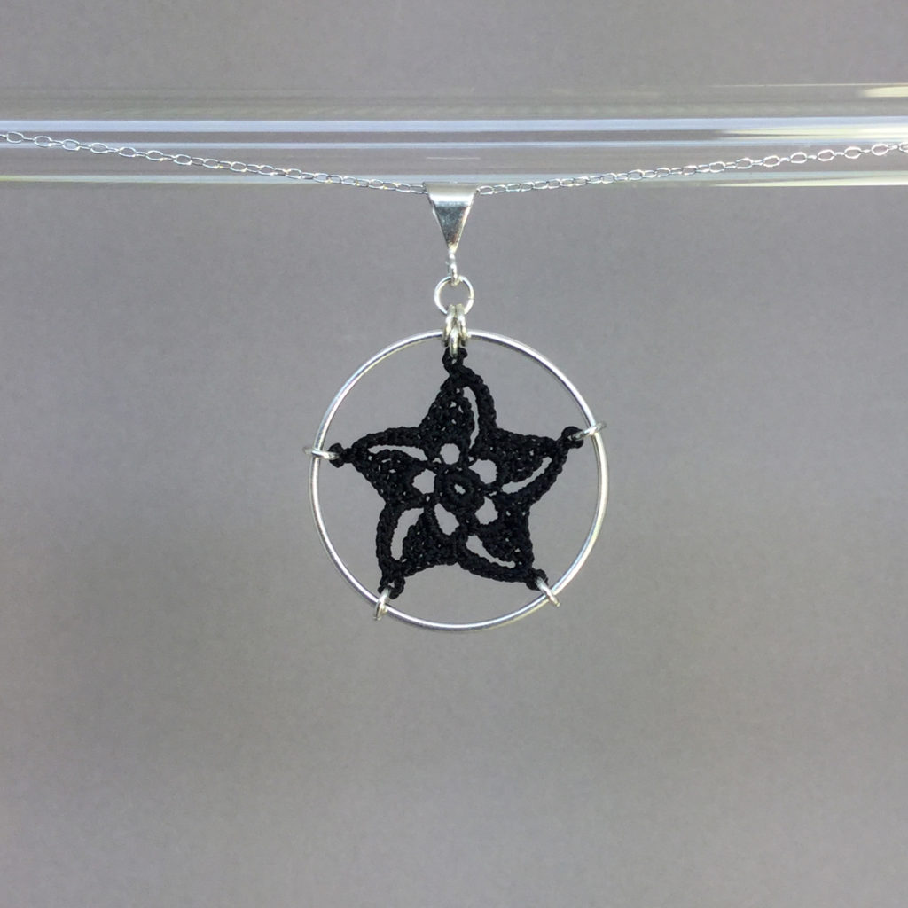 Pinwheel Star necklace, silver, black thread
