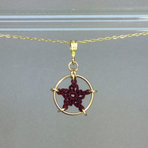 Star necklace, gold, maroon thread